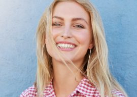cheerful-young-woman-looking-at-camera-and-PX5UHQ2.jpg